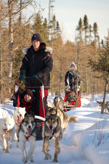 Jake and Jessica with customer dogsledding.
